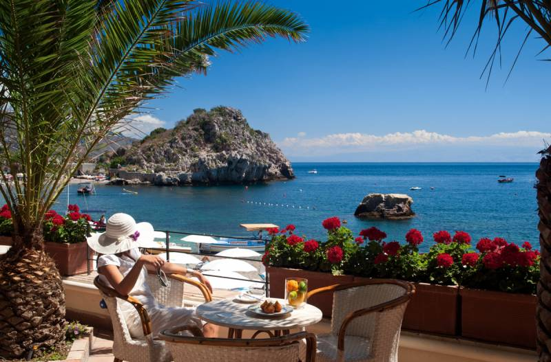 Enjoying a light lunch on the Bar terrace