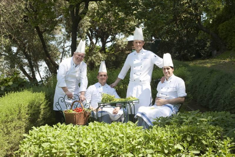 Restaurant Chefs picking fresh herbs from the garden