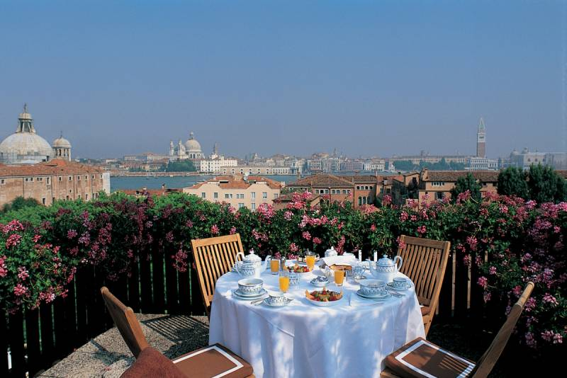 A private terrace on a roof top terrace of a suite with views over Venice