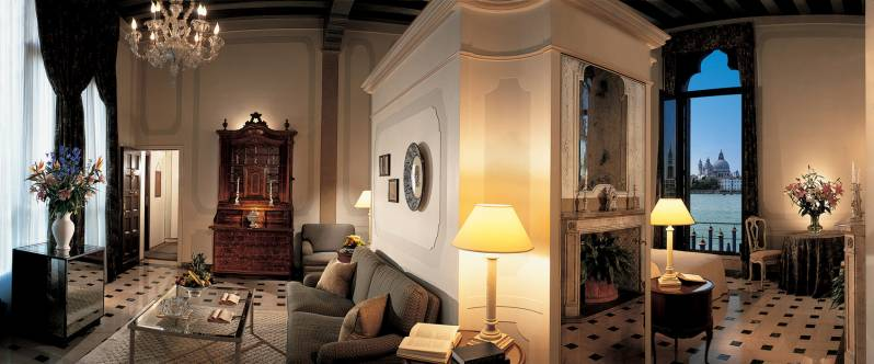 A beautiful high ceiling suite in the Palazzo Vendramin overlooking St. Mark's through its gothic window