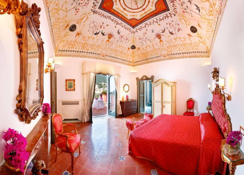 Red bedroom with original fresco