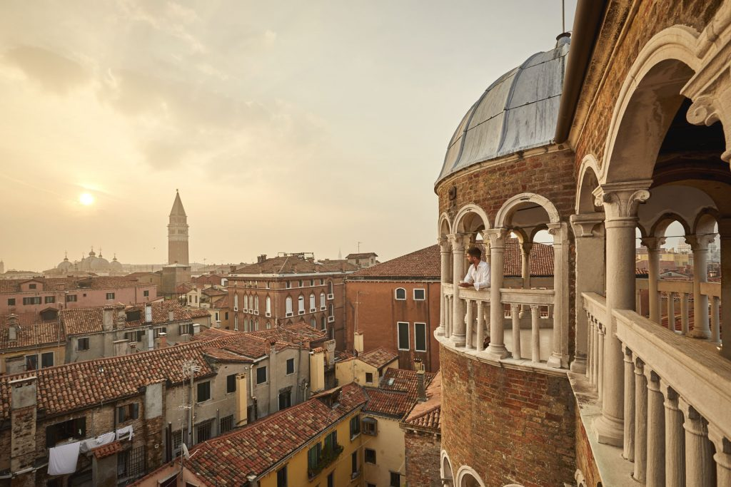 Admire Venice waking up at your feet from Scala Contarini del Bovolo