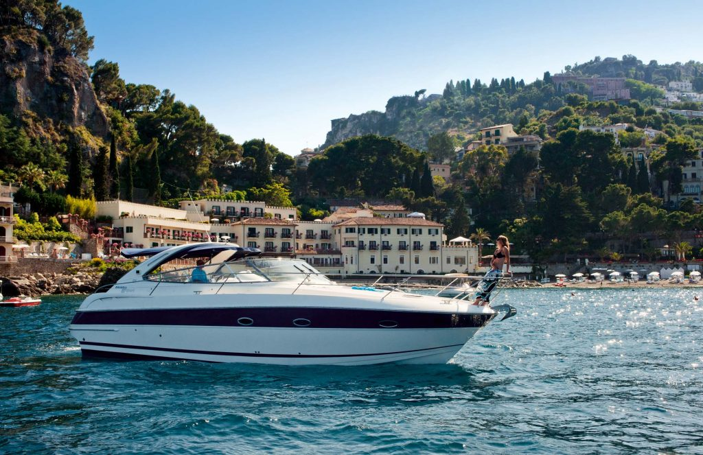 Cruise the Taormina coastline on a private boat tour in Sicily