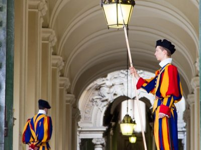 Swiss Guard Stands at an Entrance of the Vatican